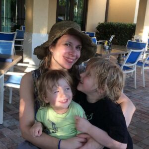 Maggie, Magnus, and Axel enjoying a hug in sunny Florida on a vacation