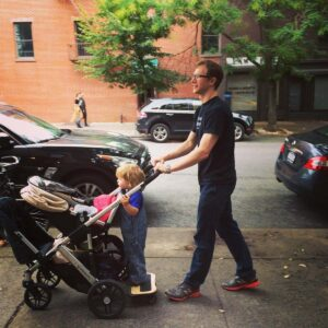 Throwback to Josh pushing baby Axel and toddler Magnus in the stroller down the street in Brooklyn