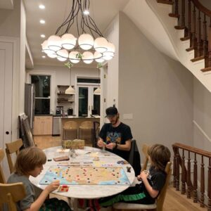 We love playing board games! This is a game called Trekking about the National Parks, played by Magnus, Axel, and Josh in our living room