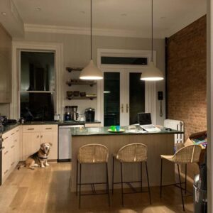Our kitchen in the evening with our late dog, Arthur, sitting in the corner. The kitchen is where we spend the most time as a family