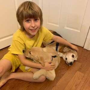 Magnus with Margene and our late dog, Arthur. He is a dog lover and it helps that Margene is very good with kids!