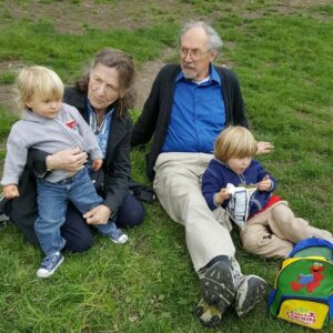 Grandma, Grandpa, and a younger Magnus and Axel enjoying a sunny day in the park