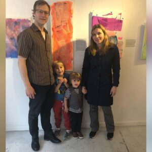 Axel's preschool art show with Mom, Dad, and Magnus